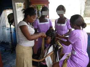Two ex-child slaves learning Hairdressing