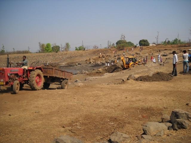 Use of Tractor & JCB to remove slush, boulders, et