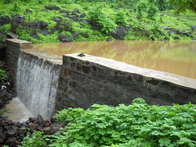 The overflowing check-dam is symbolic of Nature