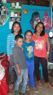 Jacqueline with her mom and younger siblings