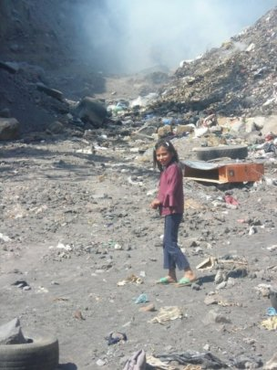 Carmen working in the dump