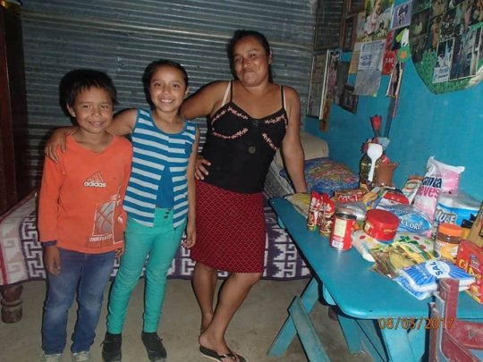 With her mom and her brother and food basket