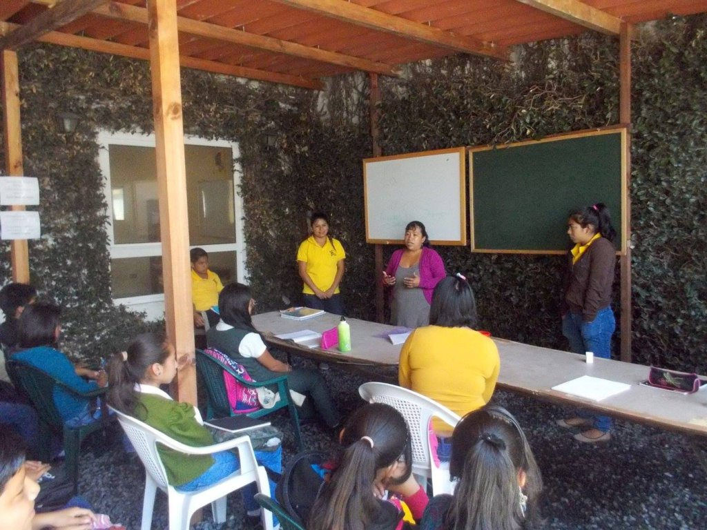 Marisol teaching a class at La Academia