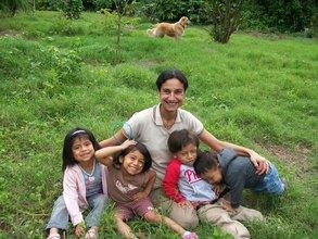 Debora with the kids in the park next door.