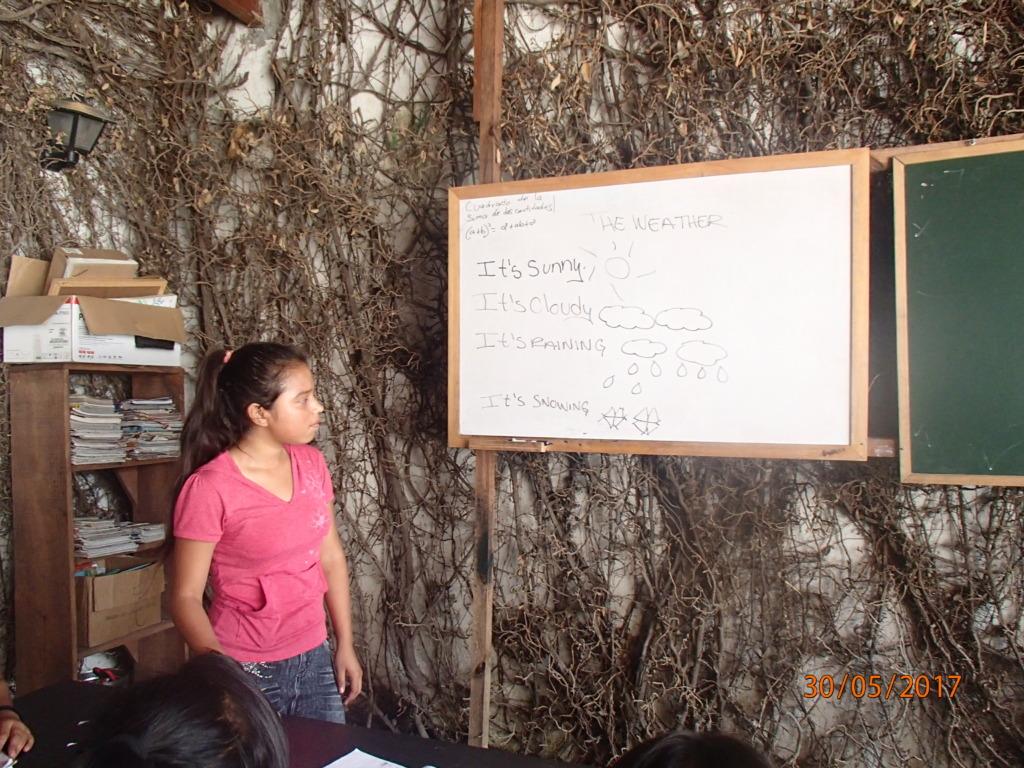 Jacqueline teaching English to her schoolmates
