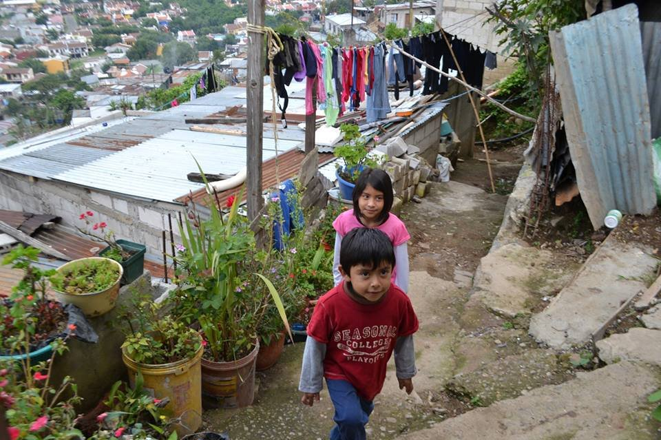 The approach to her former home in the slums