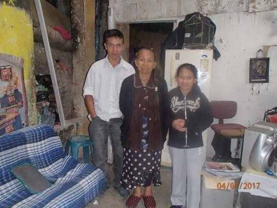 With her son and daughter at home