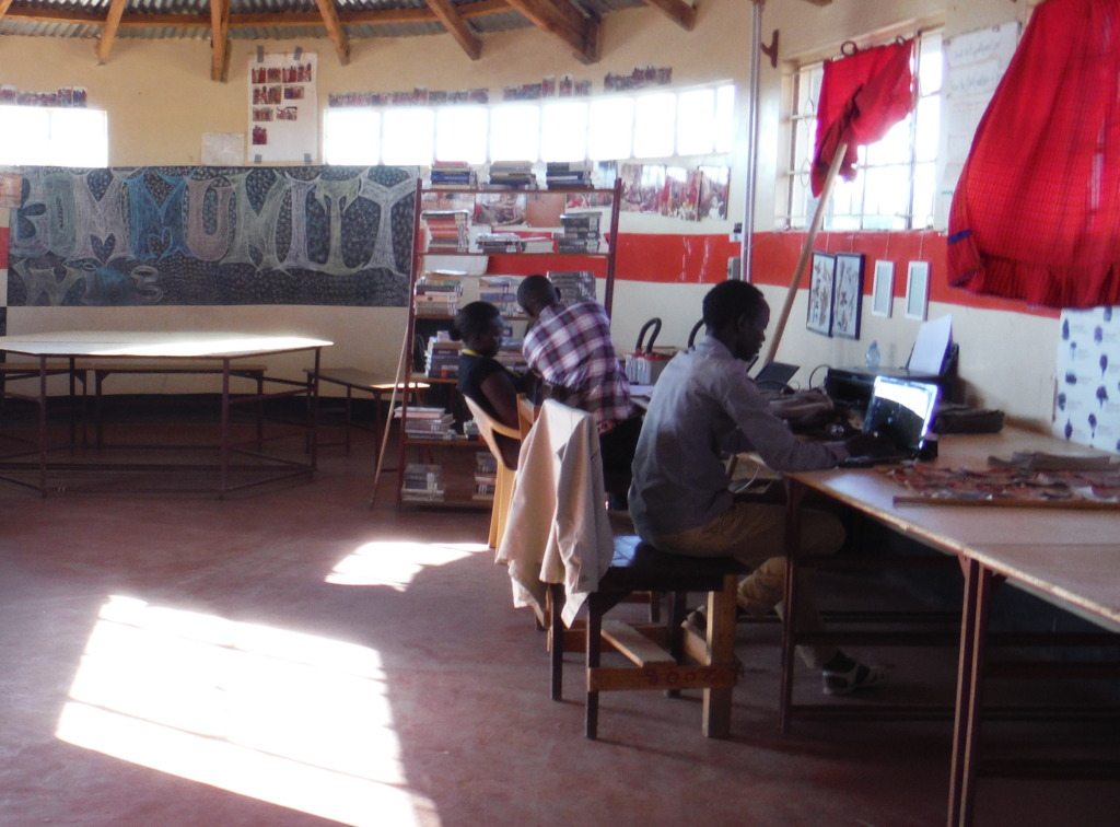 Noah teaches two students at EWRC computer lab