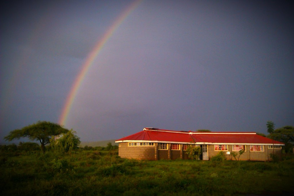 The Library under a rainy season rainbow