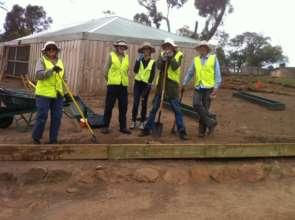 Volunteers repairing 'boardwalk' at Bonorong
