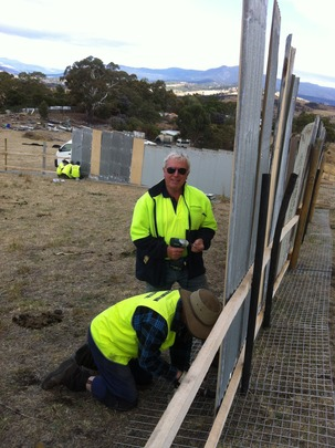 Volunteers securing the exterior fence