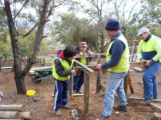 Volunteers assist with Pen Construction