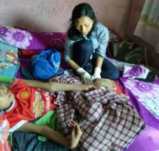 Nurse Yuni visiting her patient at home