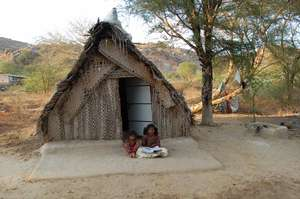 GIRL CHILDREN OUTSIDE THEIR HOME