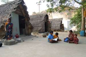 CHILDREN ARE STUDYING IN FRONT OF THEIR HOUSE