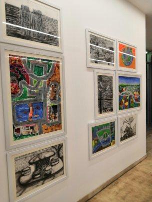 Children work at art exhibition