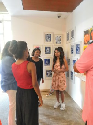 Pooja, the artist Showing her Painting