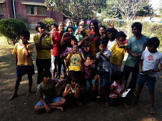 Visitors having fun with kids at Karm Marg.jpg