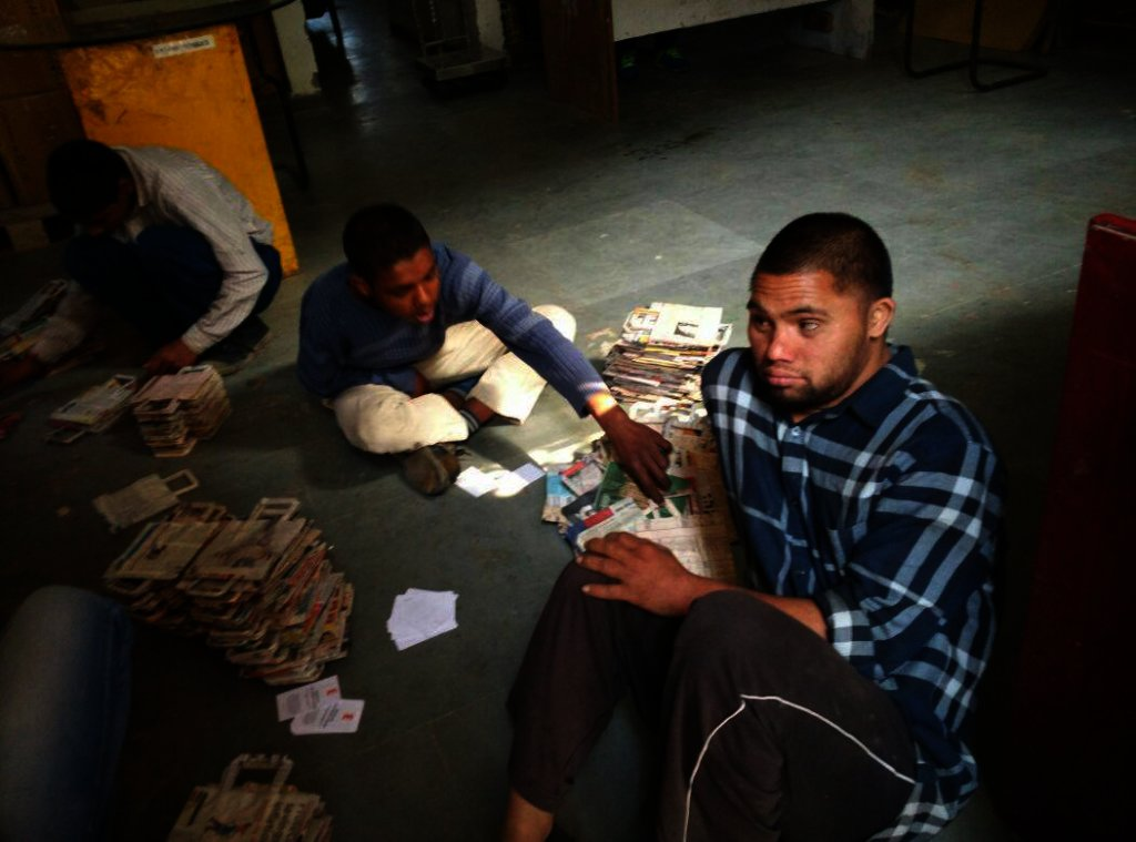 Young Adults with Special needs making newpaper bags.jpg