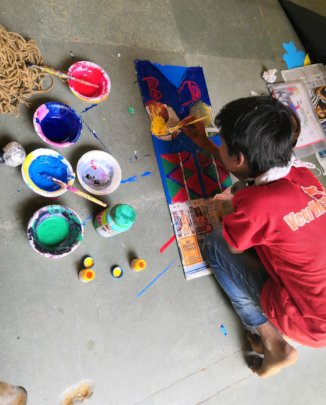 young artist busy for the exhibition