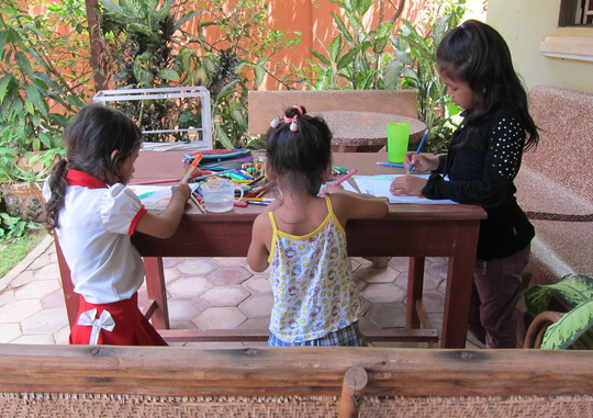 While the women learn, the children draw :)