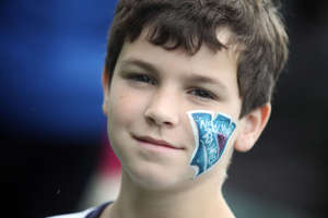 Boy at Birthday Party with face painted