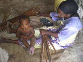 Woman working with her child