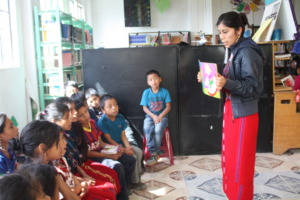 Rosa reading a story to library members