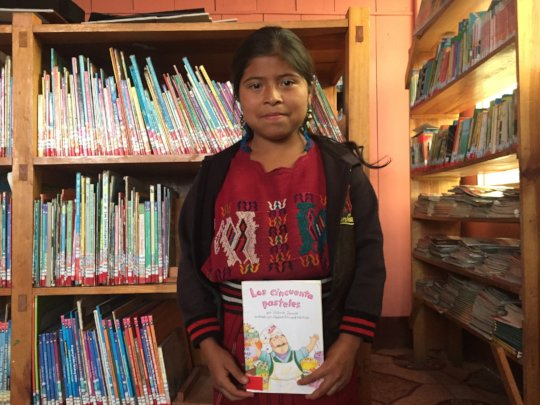 Reading club member Mirsa with her favorite book.
