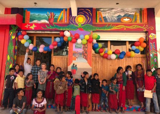 Children celebrating the mural's unveiling