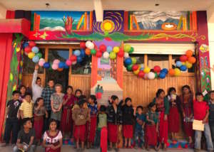 Children celebrating the mural's unveiling