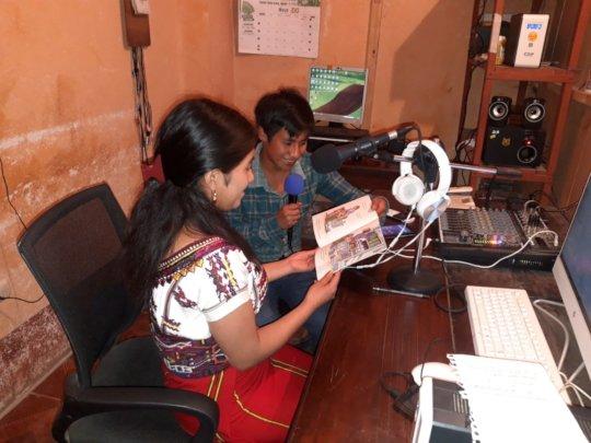Librarians, David and Olga, read on the radio.
