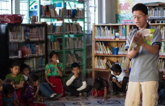 Librarian Eduardo Rey leads story hour