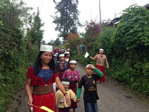 Marilu and Edilma guide the children on their way