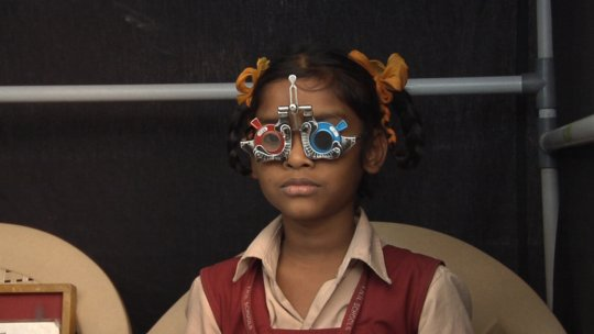 Raja gets her vision tested at her school.