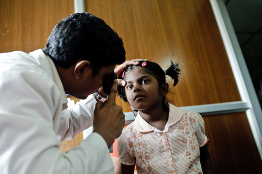 Eight-year old Sheha has her vision checked.