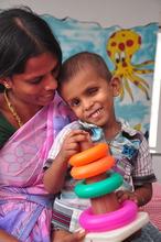 Santhosh and his mother at Aravind Eye Hospital.