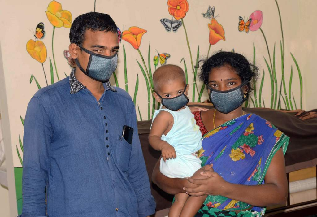 Nancy and her parents at Aravind Eye Hospital.