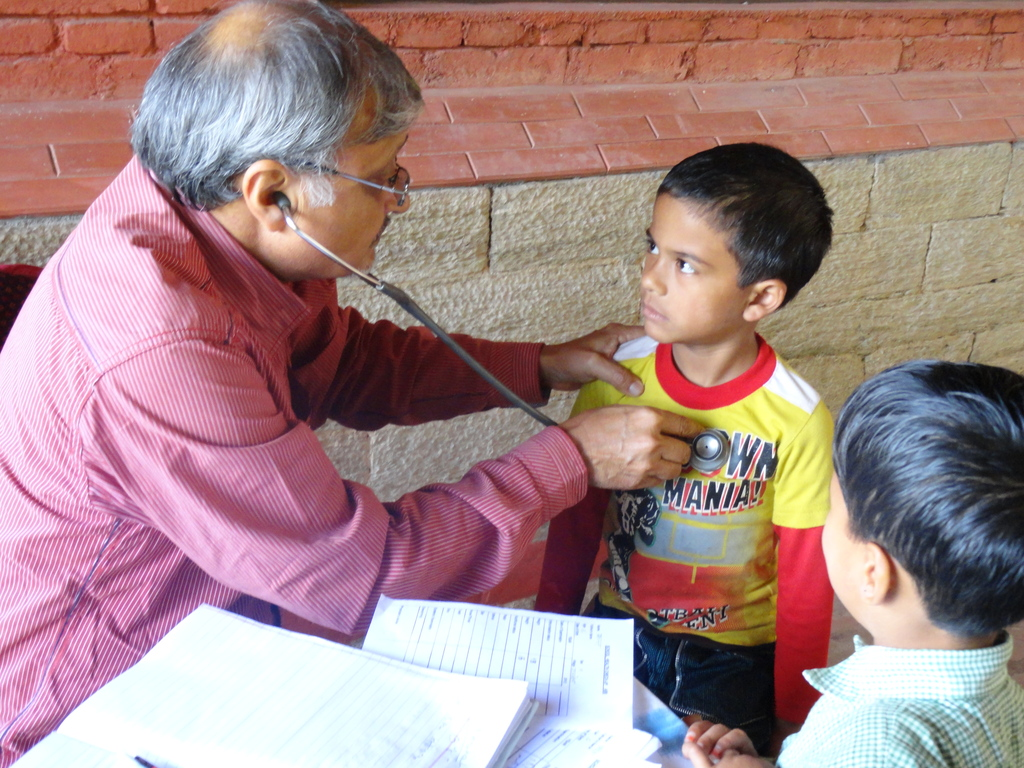Dr Nalin Pandey (Paediatrician) with school kids
