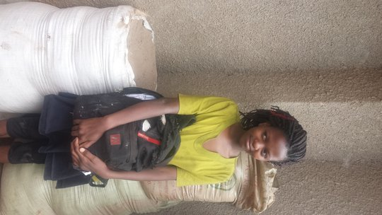 Faridah and her old school back pack