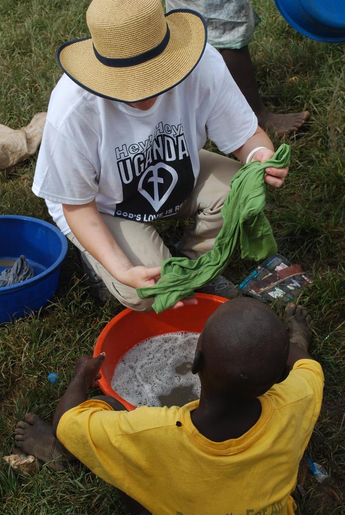 Kim helping slum children
