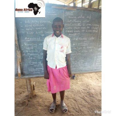 Doreen standing in class