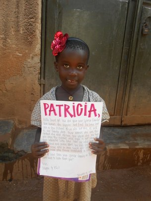 Patricia and her gift from her sponsor