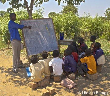 Stable, a volunteer teacher, teaching his class