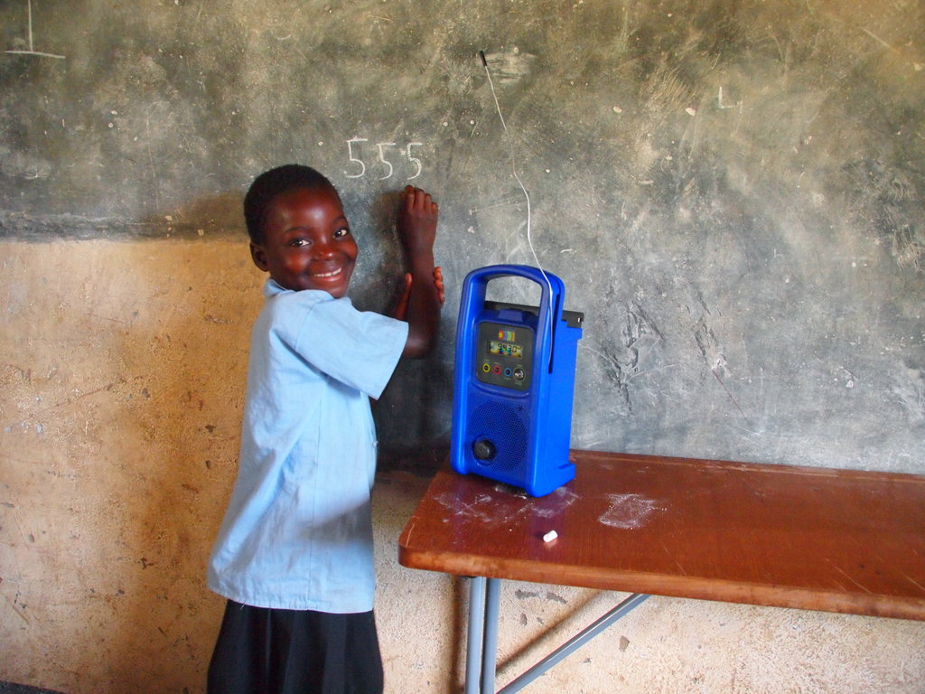 Taonga Market student Rachel follows the educational material from the radio distance education programme. Since its creation in 1999 by Zambia