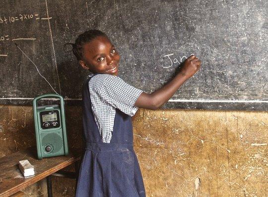 Jane writes her name on the blackboard