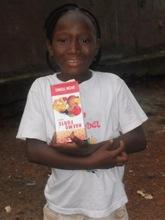 Mariama holding her vitamin supplements