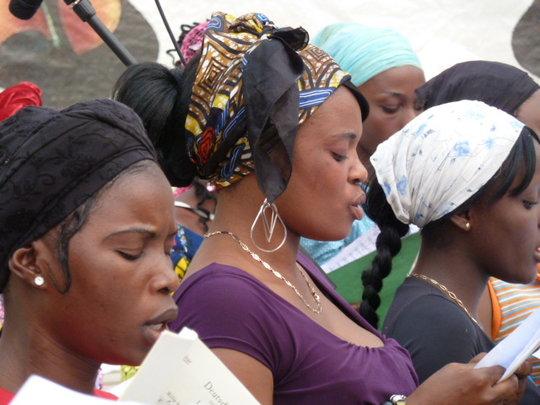 Some women of the choir rehearsing