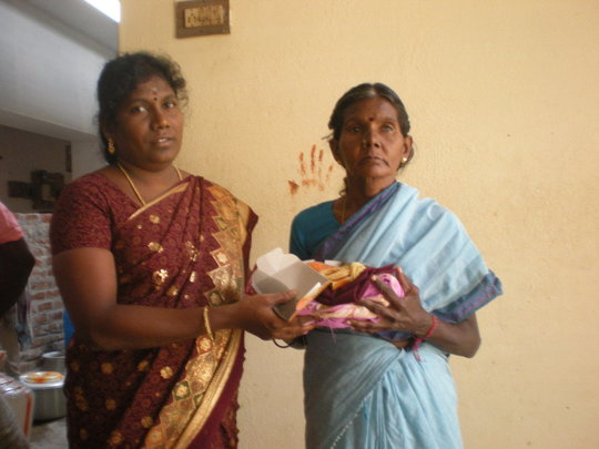 An inmate Mrs.Chellamal receiving cloth
