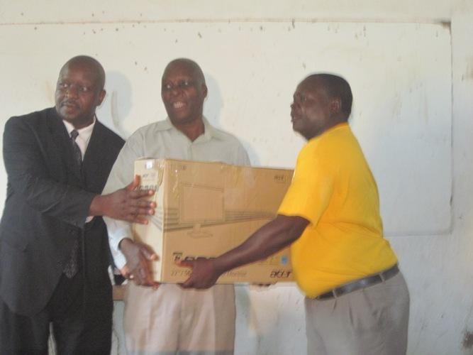 Tekeshe Foundation donating a computer